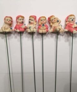 Lyserøde babyer på pind