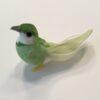Lille dekorativ lysegrøn fugl