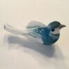 Lille dekorativ lyseblå fugl
